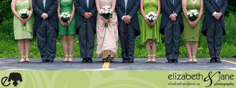 Wedding Photos: photo of the bridal party. Cropped at their busts. Grooms are clasping their hands and brides are holding their bouquets