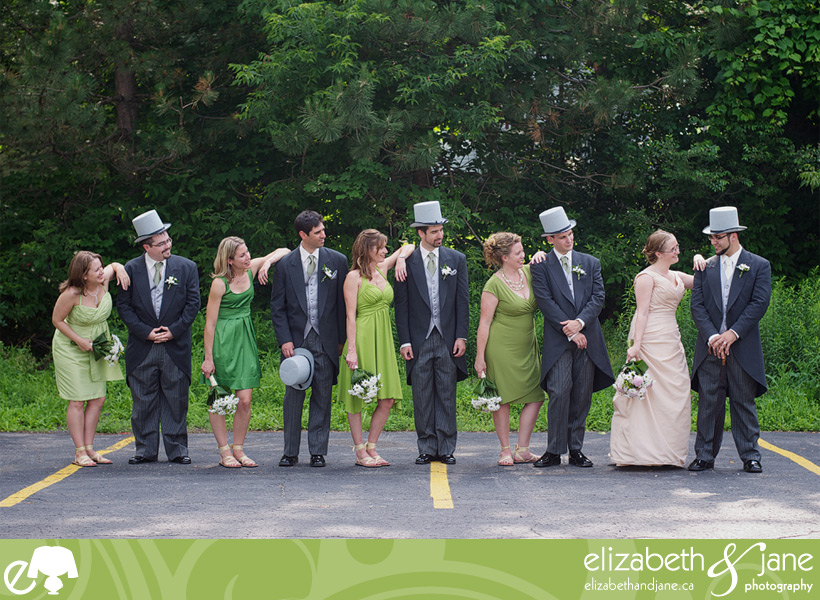 Wedding Photos: photo of the bridal party where they are looking at the bride and groom