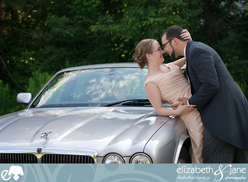 Wedding Photos: photo of the bride and groom touching noses on a Jaguar car