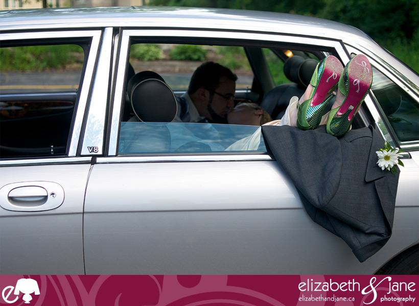 Wedding Photos: photo of the bride and groom inside a Jaguar car with their feet sticking out the window