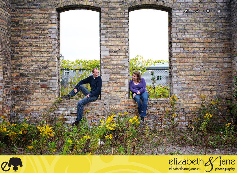 Engagement Photo: Couple sitting in a run down building