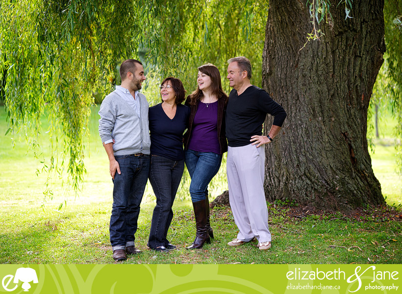 Family Photo: family of four laughing under the tree