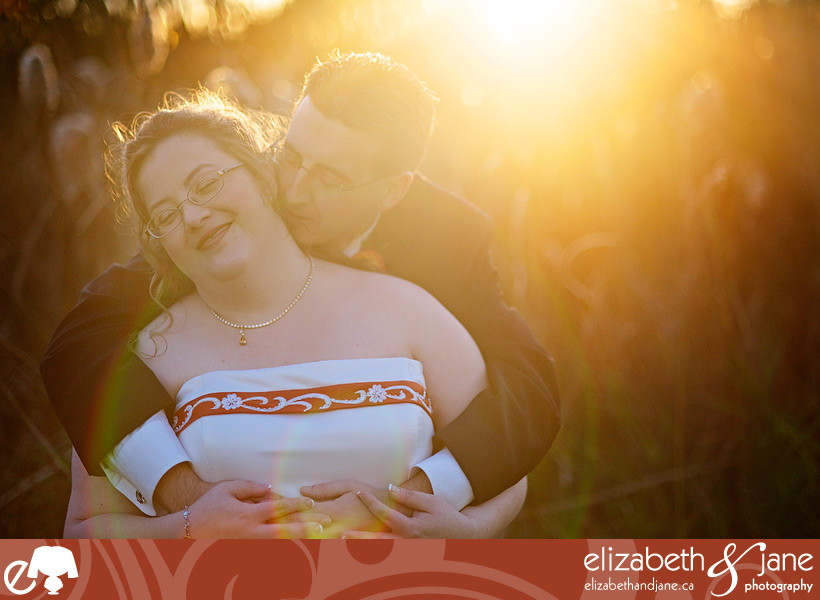 Wedding Photo: bride and groom smiling in the sunset
