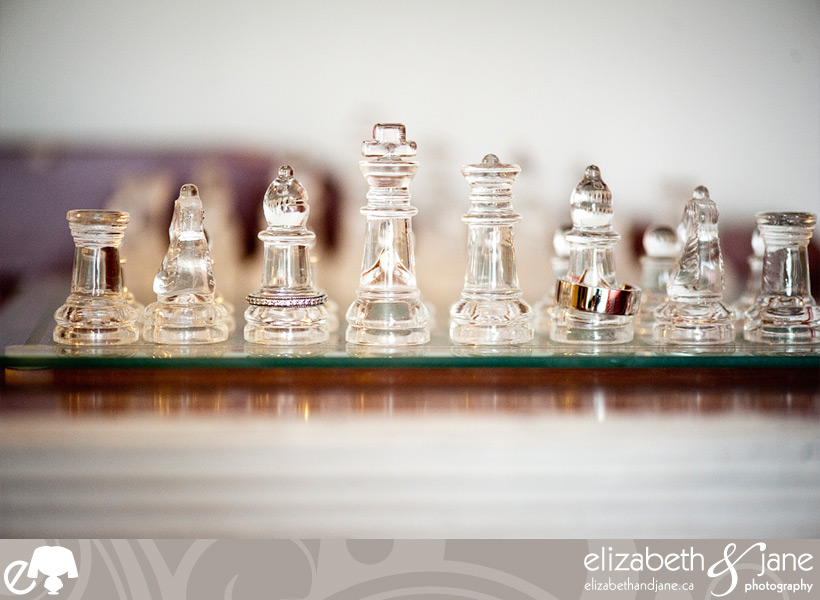 Wedding Photo: wedding and engagement rings on clear chess set