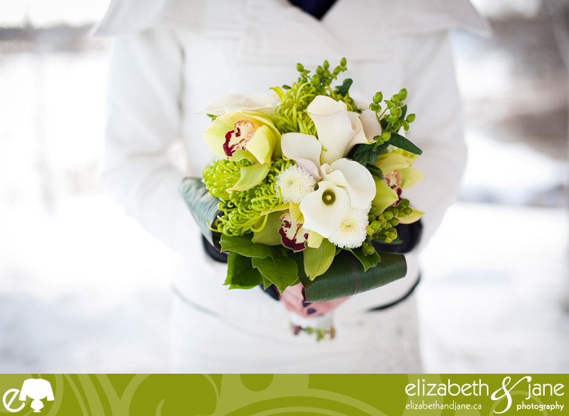 Wedding Photo: bride holding her white and green bridal bouquet