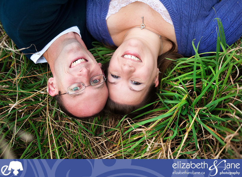 Engagement photo: couple lying in the grass
