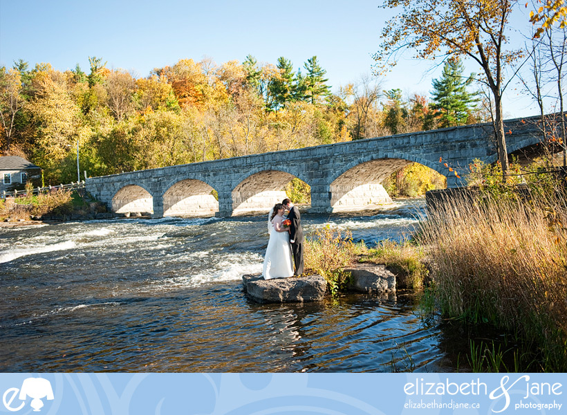 Wedding Photo: bride and groom embracing by the Pakenham Bridge
