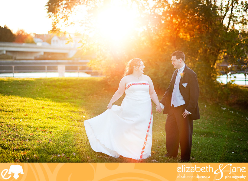 Wedding Photo: bride and groom dancing in the sunset