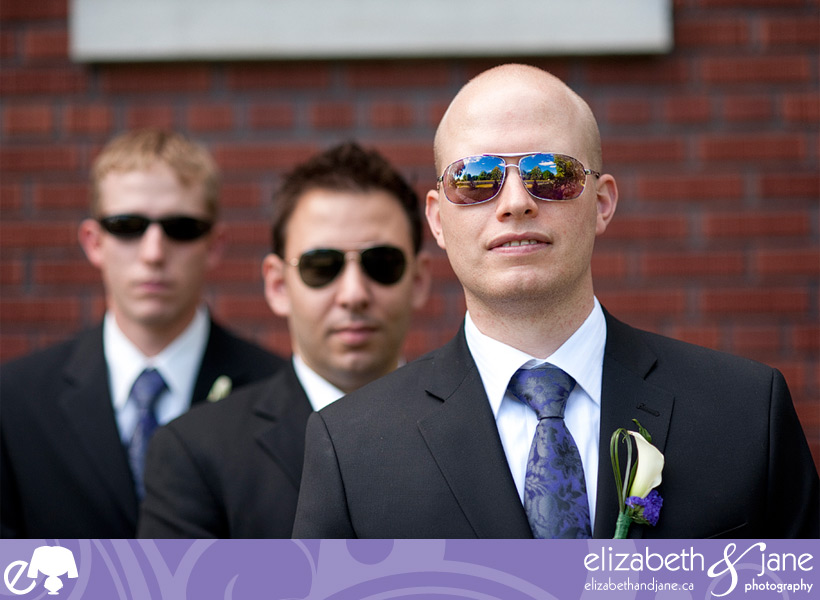 The groom and his groomsmen wearing reflective sunglasses.