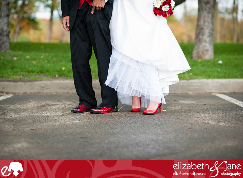 Wedding Photo: bride and groom in their red shoes